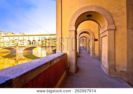 Arno river coastline and Ponte Vecchio bridge in Florence view, Tuscany region of Italy poster
