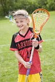 Happy lacrosse player with her stick poster