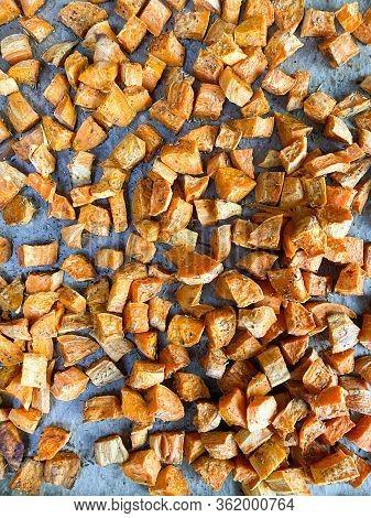 Fresh Baked Orange Sweet Potato Chunks With Rosemary Seasoning