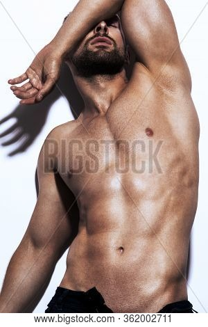 Portrait Of Strong Healthy Handsome Athletic Man Fitness Model Isolated On White