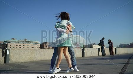 A Girl And A Guy Dance A Spanish Dance On The Street To Live Music. Musicians Play Outside, And Pass