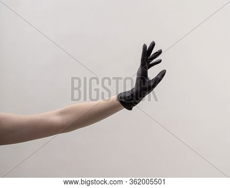 Aesthetic Female Hand In A Black Glove.
