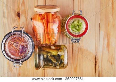 Fermented Preserved Vegetarian Food Concept. Sour Sauerkraut, Pickled Carrots, Pickles, Pickled Cele