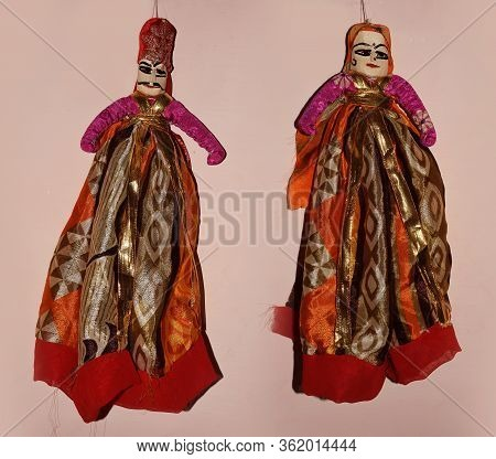 Rajasthan Puppets Isolated On A Light Background. Puppets In India Are Also Known As Kathputli