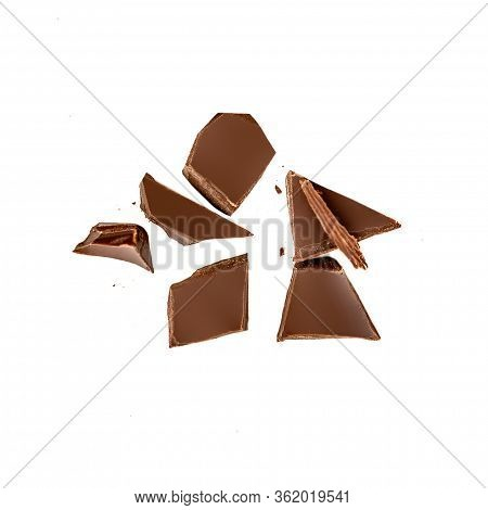 Dark Chocolate Pieces Isolated On White Background.  Chocolate Bar Chunks, Shavings And Cocoa Crumbs