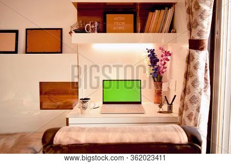 Abstract Background Of Home Office Interior Workspace Desk With Coffee Cup, Green Screen Laptop, Lam