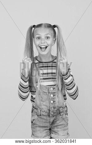 Positive Energy. Split Ends Treatment. Joyful Baby. Girl Cute Smiling Child Long Hair Double Ponytai