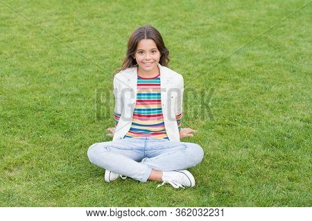 Importance Of Relaxation. Little Schoolgirl. Relax At School Yard. Kid Relaxing Outdoors. Peace Of M