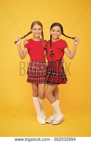 True Friends. Cheerful Friends. Happy Together. School Girls Having Fun Together. Cute Little Girls