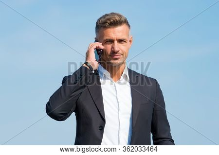 Hello, Answer The Phone. Businessman Call On Mobile Phone. Handsome Man With Cell Phone Outdoors. Bu