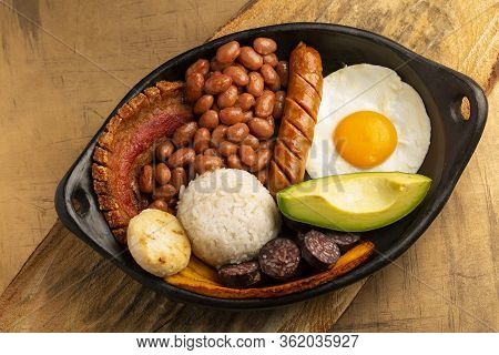 Bandeja Paisa, Typical Dish At The Antioqueña Region Of Colombia. It Consists Of Chicharrón (fried P