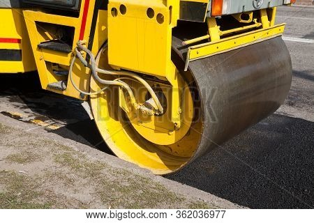 Pavement Machine Laying Fresh Asphalt Or Bitumen On Top Of The Gravel Base During Highway Constructi