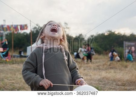 Funny Cute Little Girl Screams In Displeasure. The End Of The Holiday, Its Time To Go Home. Outdoor