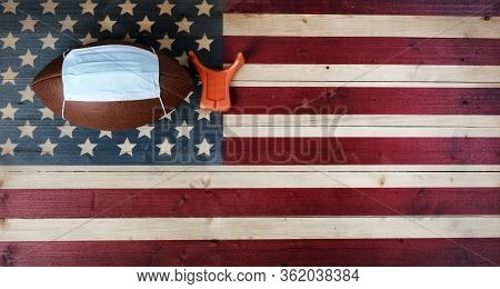 American Football With Surgical Protective Mask And Kicking Tee On Vintage United States Wooden Flag