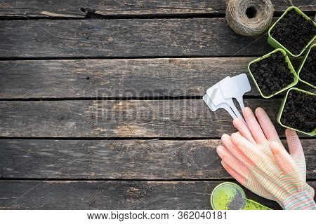 Gardening Tools On Wooden Garden Table Flat Lay Background With Copy Space.