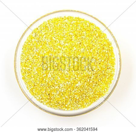 A Pile Of Corn Grits On A White Bowl, Isolated On A White Background, Top View. A Dietary Culinary D