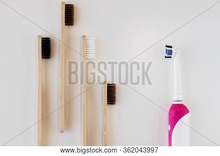 Bamboo Toothbrushes Vs Plastic Toothbrush Concept. Dental Zero Waste And No Plastic Concept. Copy Sp