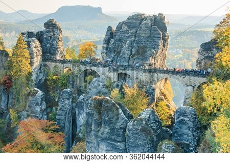 Bastei Bridge In Saxon Switzerland In Autumn Mood. Rocks And Trees With Blue Sky And Sunshine. Elbe