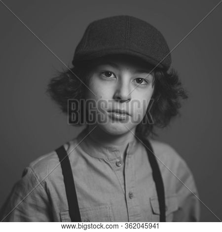 Portrait Of A Boy In A Cap. Black And White.