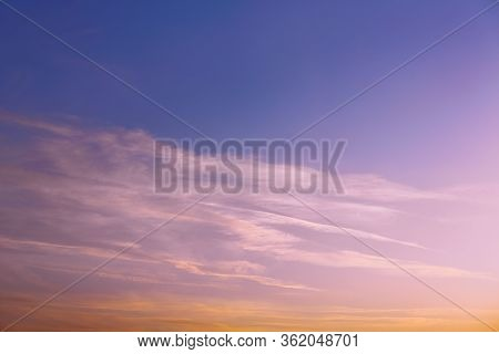 There Is A Bright Photo Of A Pink Sunset Or Dawn. Luminous Clouds In The Rays Of The Setting Sun. Co