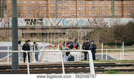 Kehl, Germany - Mar 16, 2020: German Polizei Police Officers Checks People At The Border Crossing In