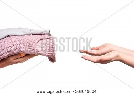 Woman Holding Clothes, Donation Concept. The Girl Transfers Old Clothes As A Donate And Humanitarian