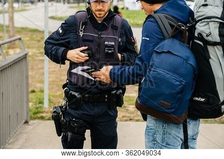 Kehl, Germany - Mar 16, 2020: German Polizei Police Officers Id Passport Check People At The Border