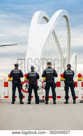 Vertical Image Of Unrecognizable German Polizei Police Officers Checks Traffic At The Border Crossin