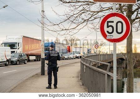 Kehl, Germany - Mar 16, 2020: Surveilling Traffic German Polizei Police Officer Inspecting The Borde