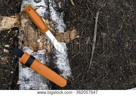A Knife With A Fixed Blade And A Bright Orange Handle. Bushcraft Knife Tourist. The Knife Lies On A