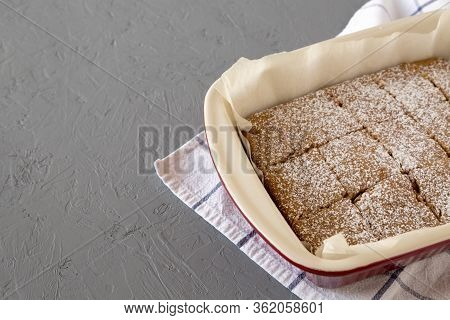 Homemade Tasty Applesauce Cake On A Gray Background, Low Angle View. Copy Space.