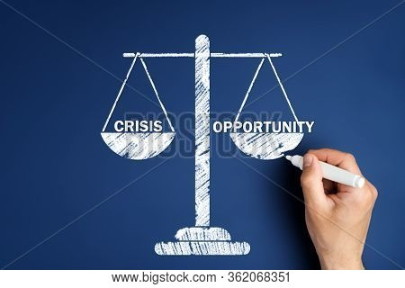 Male Hand Draws Scales With The Words Crisis And Opportunity. Recession Business Choice Concept
