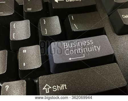 Business continuity plan on computer keyboard
