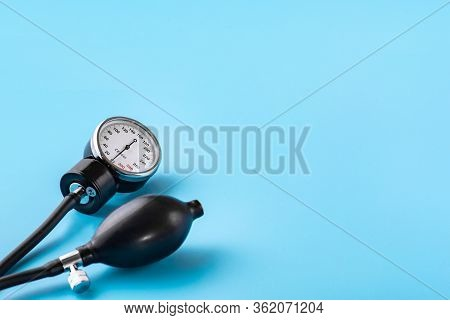 Device For Measuring Blood Pressure. Tonometer, Cuff, Stethoscope On A Blue Background. Copy-space.