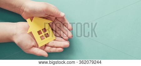Hands Holding Paper House, Family Home, Homeless Housing And Home Protecting Insurance Concept, Inte