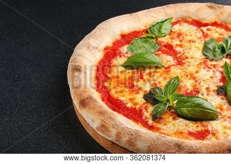 Pizza Margherita On Black Stone Background. Pizza Margarita With Tomatoes, Basil And Mozzarella Chee