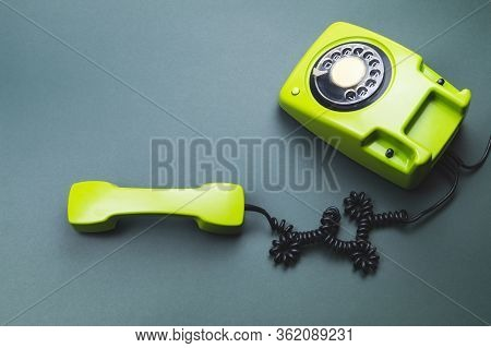 Classic Phone With Handset. Vintage Green Telephone With Phone Receiver. Office Background. Old Comm