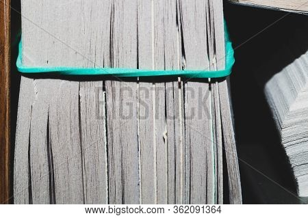 Book With Soft Cover. Paperback Close Up. Book Edge Macro. Pages Pulled Together With An Elastic Ban