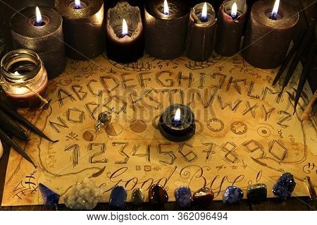 Spiritual Magic Board With Alphabet And Numbers, And With Black Candles.  Wicca, Esoteric And Occult