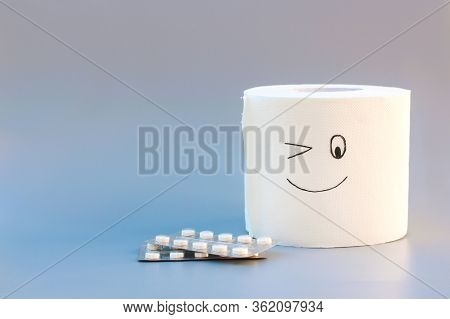 Toilet Paper And Pills. Concept Of Hemorrhoid Treatment.