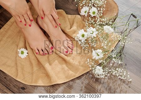 Close-up Image Of Woman Wiping Feet With Soft Towel After Soaking Procedure