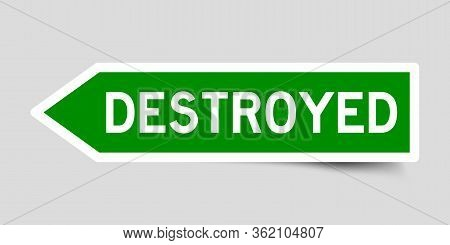Green Color Arrow Sticker With Word Destroyed On Gray Background