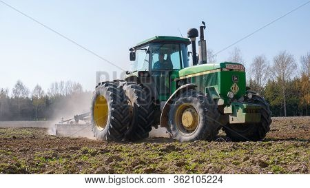 Nagybajcs Hungary 04 04 2020: A Large, Modern John Deere 4755 Tractor With Double Wheels Goes In The