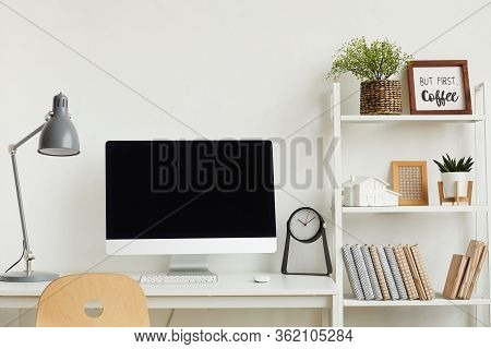 Background Image Of Modern Computer On Desk Against White Wall In Home Office Interior, Copy Space A
