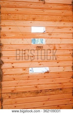 Glued Wooden Beam For Building A House. Building A House From A Wooden Beam. Yellow Wall Of Wooden H