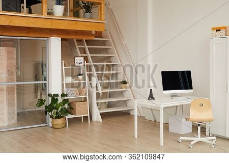 Background Image Of Contemporary Two Level Apartment Interior With Home Office Workplace In Foregrou