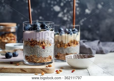 Breakfast Parfait With Chia, Granola, Berries And Yogurt In A Glass. Layer Dessert In A Glass.