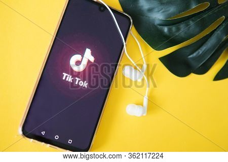 Tver, Russia-april 9, 2020, The Tik Tok Logo On A Smartphone Screen On An Yellow Background With Hea