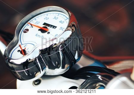 Chrome Speedometer On A Motorcycle. White Speedometer With Red Arrows.