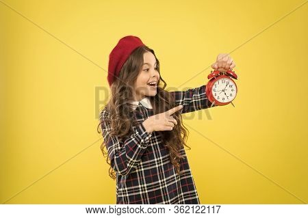 Girl With Alarm Clock. Set Up Alarm Clock. Child Little Girl Hold Red Clock. It Is Time. Always On T